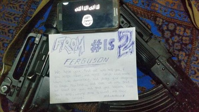 An ISIS member uploaded this photo presenting a message to Ferguson rioters.