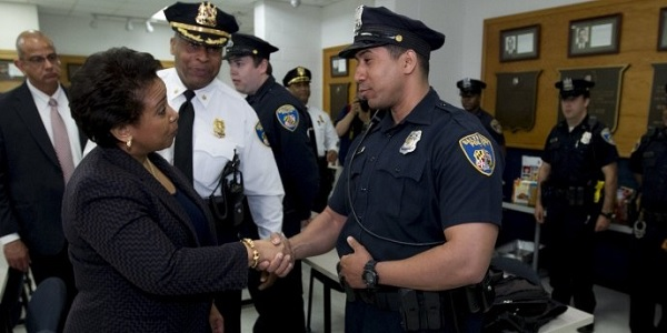 """U.S. Attorney General Loretta Lynch, shown here with Baltimore police, announced the new """"Strong Cities Network"""" to plug local departments into international cooperation and """"shared resources"""" with their peers across the globe."""