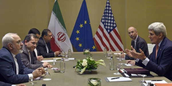 Secretary of State John Kerry (far right) negotiates with Iranians