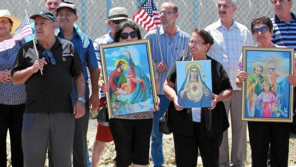 Iraqi Chaldean Catholics rally in support of 27 Chaldeans being held at an ICE detention center in California.
