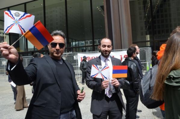 Robert DeKelaita, left, at a support rally with Assyrian Christians.
