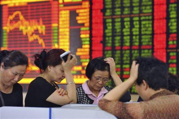 Chinese traders looking stressed during one of the many down days at the Chinese stock market during Shemitah 2014-15