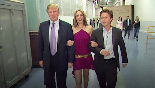 "In this screenshot of a video from 2005, Donald Trump prepares for an appearance on ""Days of Our Lives"" with actress Arianne Zucker. He is accompanied to the set by ""Access Hollywood"" host Billy Bush"