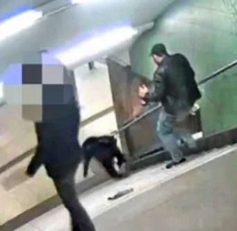 man-kicks-woman-down-stairs-berlin-subway-300
