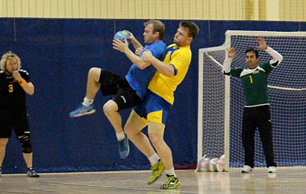Transgender handball player Hannah Mouncey (in yellow), known as Callum in this photo before he transitioned from a male into a female