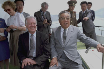 Former President Jimmy Carter with Kim Il-sung in 1994