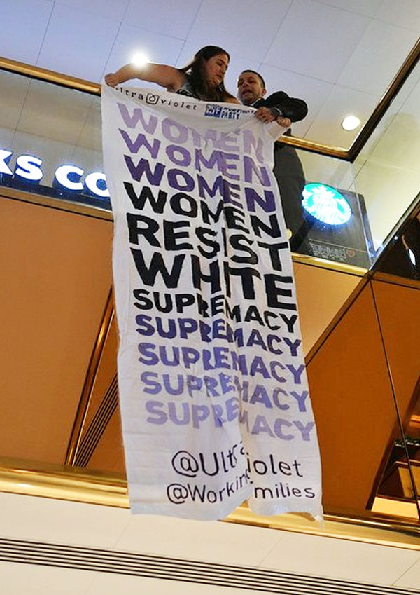 UltraViolet activist Melissa Byrne smuggled a 10-foot banner under her dress and unfurled it on the second floor of Trump Tower. It read: 'Women Resist White Supremacy'