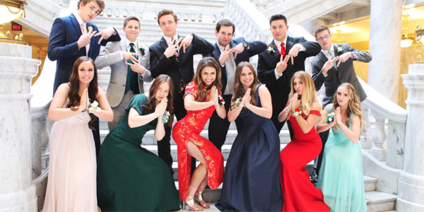 Keziah Daum, an 18-year-old student in Utah, tweeted photos of herself with friends before her senior prom. Some accused her of cultural appropriation because she wore a traditional Chinese dress (Photo: Keziah/Twitter)