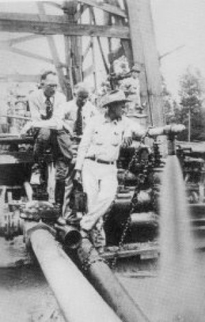 George Strake, left, at the Conroe oil field