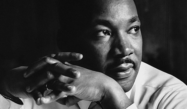 MLK looking left with hands intertwined