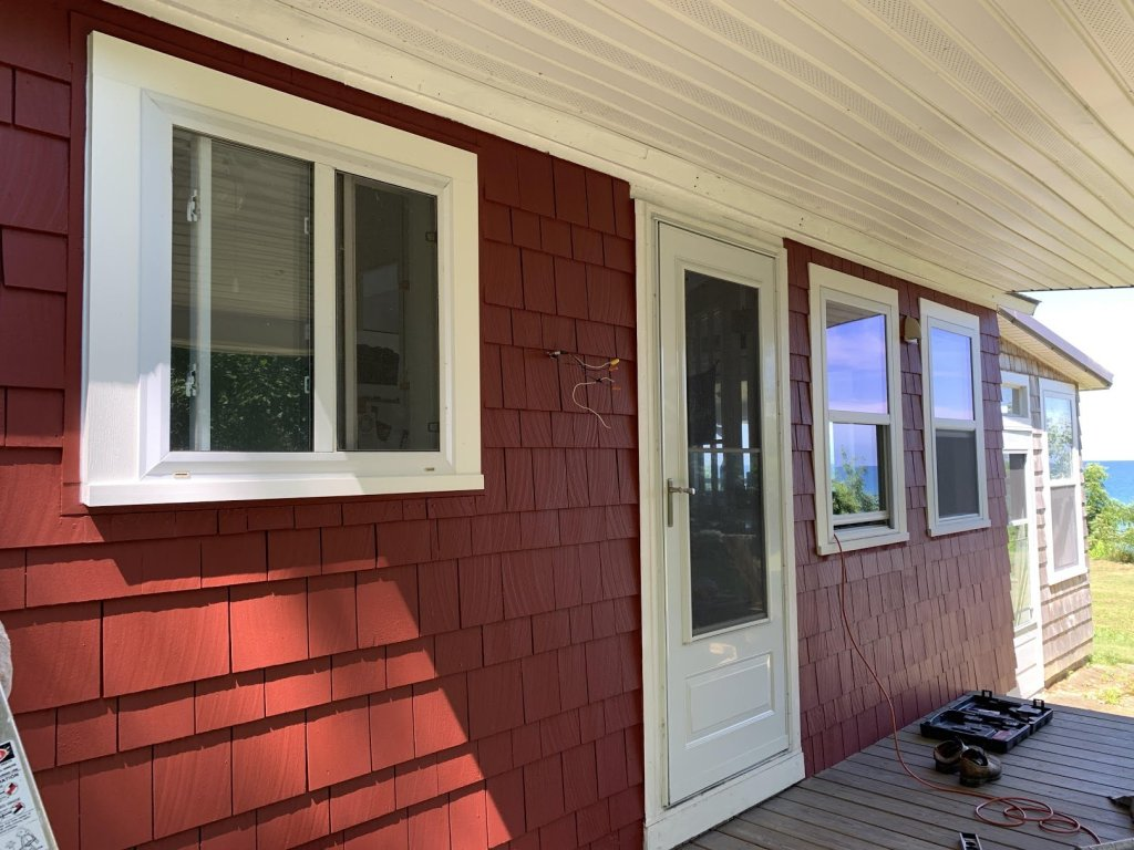 red and white shingle style cottage New York