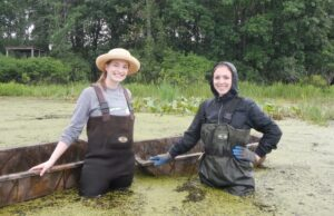 Julia Kostin and Rebecca Mann (2018 WNY PRISM Crew) take a break from their water chestnut search at the Audubon Community Nature Center. Photo Credit: WNY PRISM.