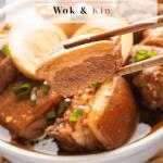 Pork belly held up by chopsticks