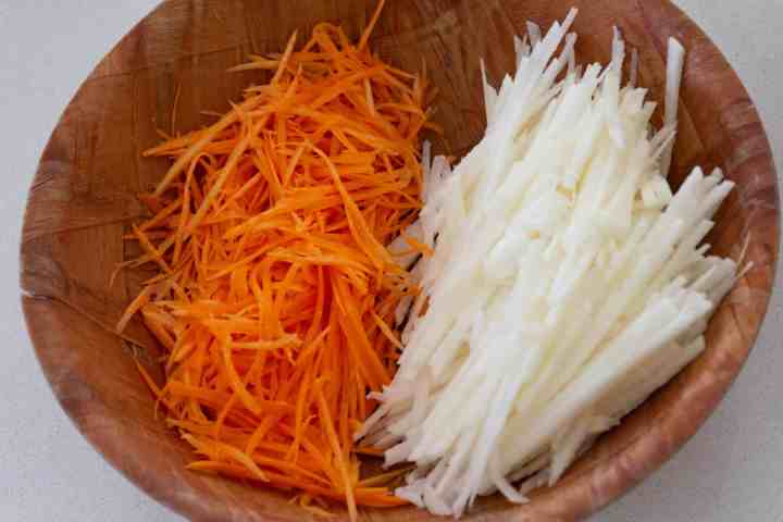Bowl with sliced jicama and julienned carrots