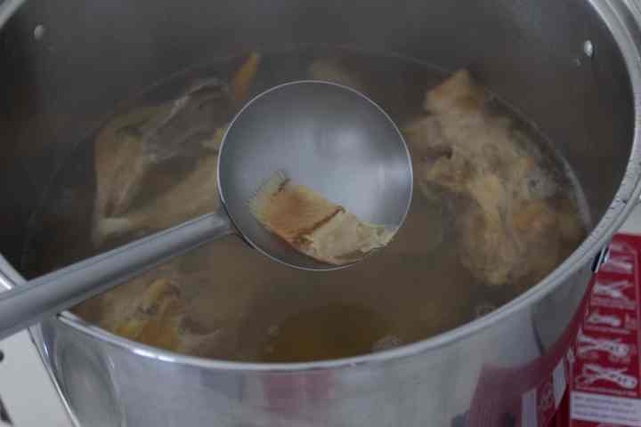 Preserved fish in pot of broth