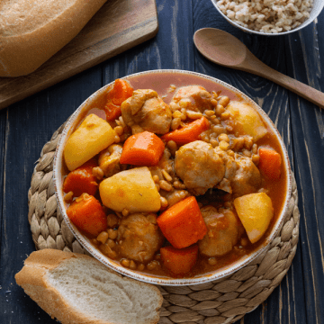 Vietnamese Chicken Ragu in a bowl with baguettes and rice near it