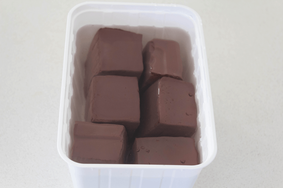Cooked blood jelly in a container of water