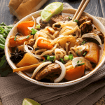 Vietnamese beef stew with noodles in a bowl