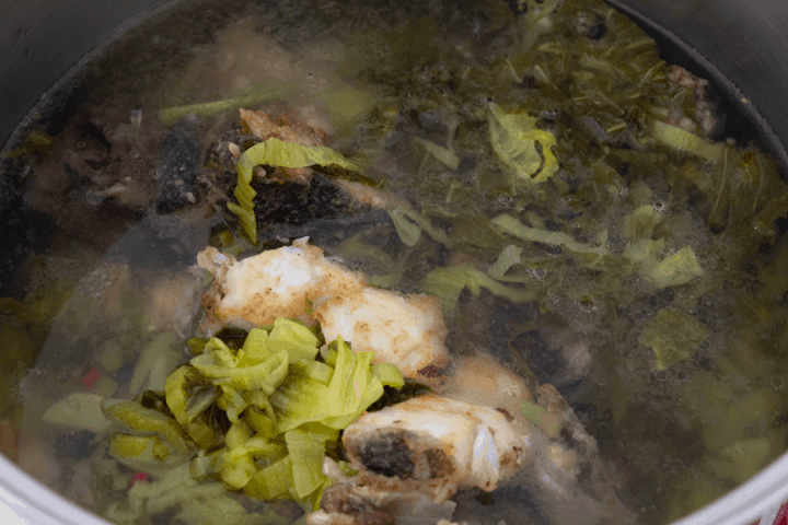 Fish and mustard greens in water