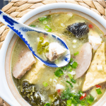 Chinese fish soup in a bowl with a spoon
