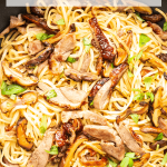 Noodles with roast duck in a pan