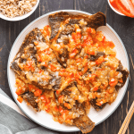 Fried fish with tomato sauce on a plate