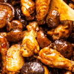 Wings and mushrooms in a wok