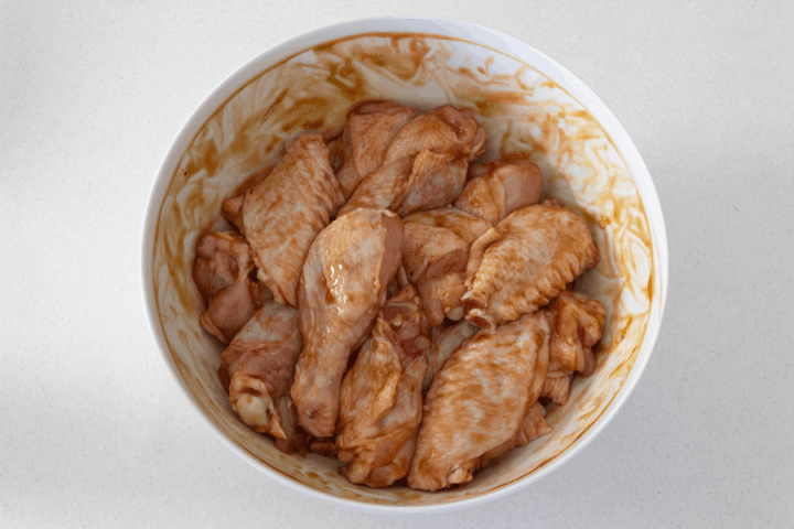 Chicken wings marinating in a bowl