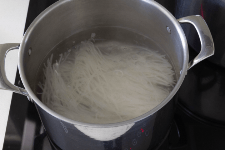 Rice noodles in a pot with water
