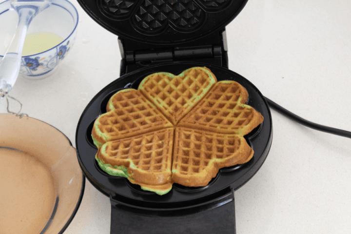 Pandan waffle in a waffle maker