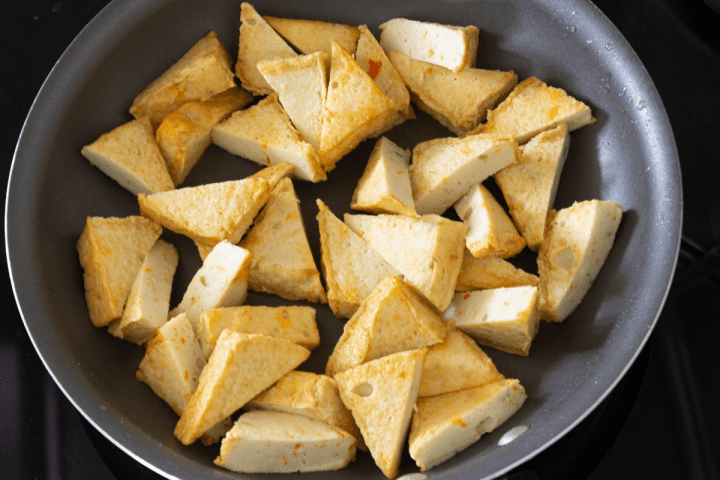 Halved vegetable tofu in a pan.