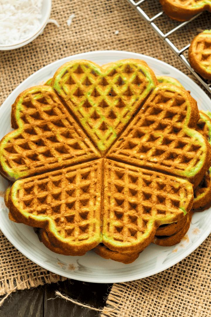 Pandan Waffles stacked on a plate.