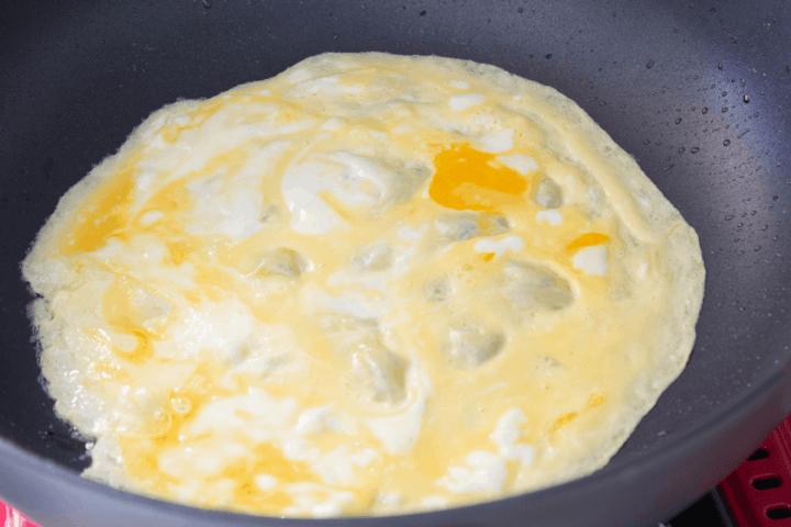 Omelette in a wok.