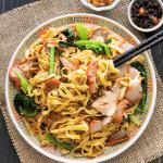 Char Siu Noodles on a plate with chopsticks.