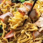 Chopsticks grabbing Char Siu Noodles.