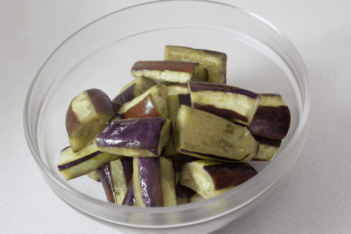 Cooked eggplant pieces in a bowl.