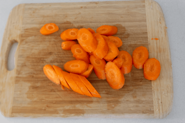 Sliced carrots on a chopping board.