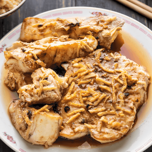 Steamed Fish with Black Bean Sauce on a plate.