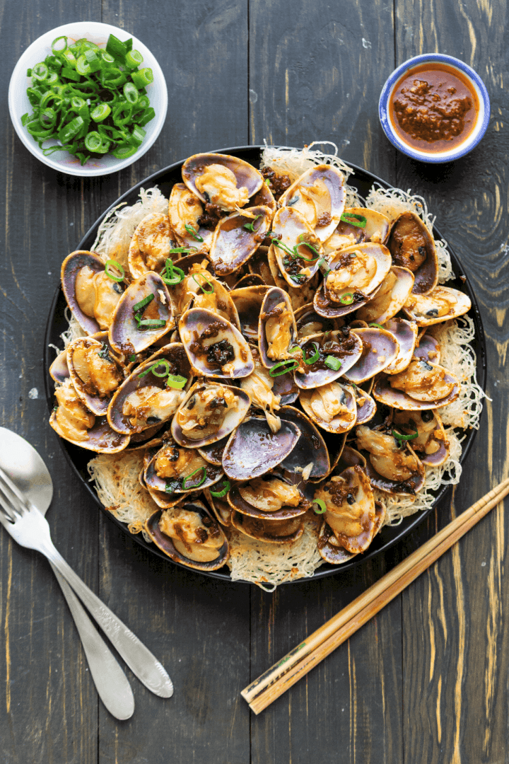 XO Pipis with Crispy Noodles on a plate.