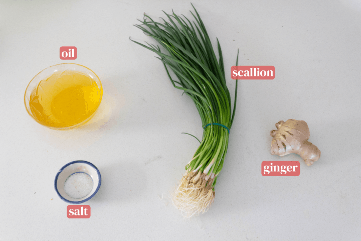 Scallions, a bowl of oil, a dish of salt and ginger.