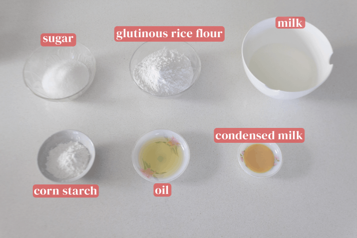 Bowls of corn starch, glutinous rice flour, milk and sugar along with dishes of oil and condensed milk.