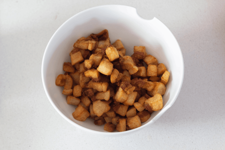 Fried pork fat cubes in a bowl.