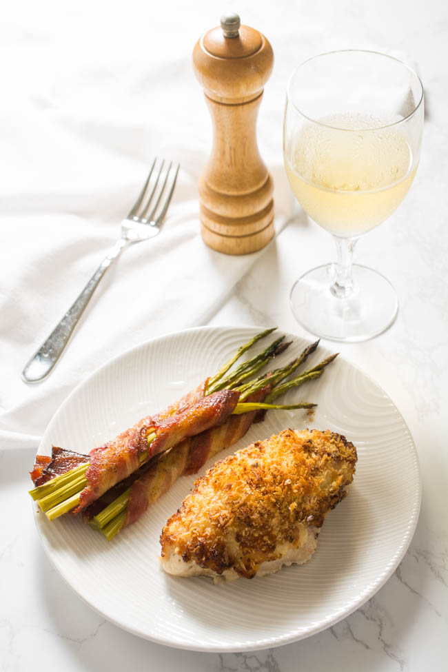 Parmesan Crusted Chicken is guaranteed to turn out super-moist and juicy every single time. Takes just minutes to prepare which makes it perfect for a family weeknight meal yet it is elegant enough for your next romantic evening in.