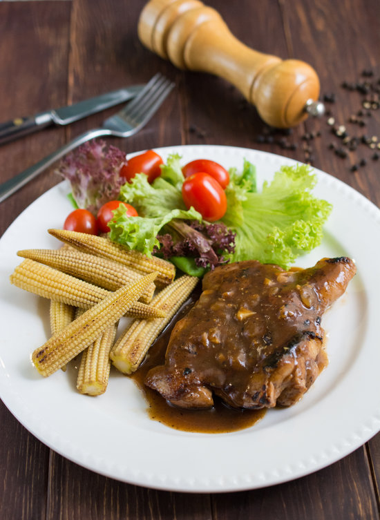 Chicken Chop with Black Pepper Sauce - Delicious grilled marinated chicken covered in a rich, bold black pepper sauce.