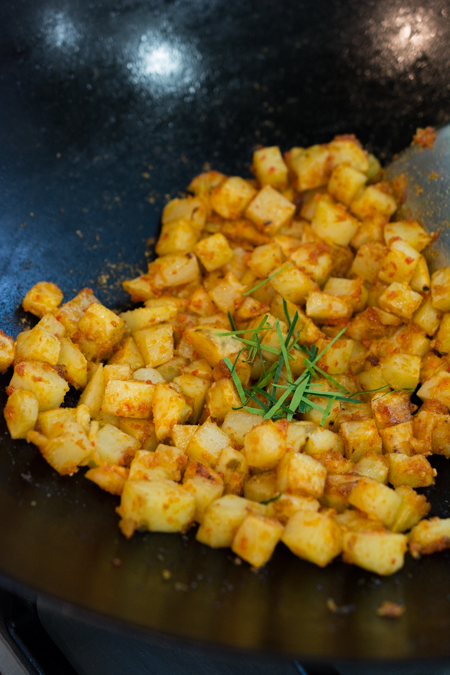 Spicy Fried Potatoes (Indonesian Sambal Goreng Kentang) is the Indonesian version of home fries. It's spicy, sweet and tangy. Serve as a side dish, or enjoy over steamed rice.