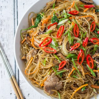 Japchae is a classic Korean noodle dish that can be served as a side dish, main dish, or over rice. Stir-fried glass noodles with sliced beef, julienned carrots, vegetables and mushrooms, tossed in a sweet soy sauce dressing.