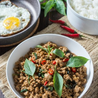 Thai Basil Chicken (Pad Krapow Gai or Gai Pad Krapow) is a classic Thai stir-fry where the amazing aroma of basil pairs so well with the savory sauce. Serve over steamed jasmine rice and top with a fried egg for the ultimate Thai comfort food; all ready in less than 20 minutes!