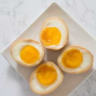 Half-Boiled Ajitama (Seasoned Ramen Eggs) have slightly firm egg whites and luscious custard-like yolks. The sweet soy seasoning gives them unbelievable flavor. Famously used as a topping for ramen but can be enjoyed as a snack anytime.