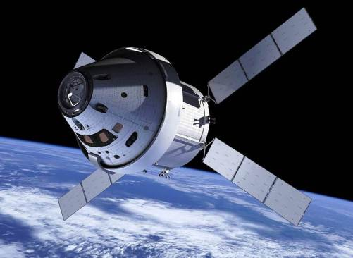NASA's Orion spacecraft in flight. Earth in background.