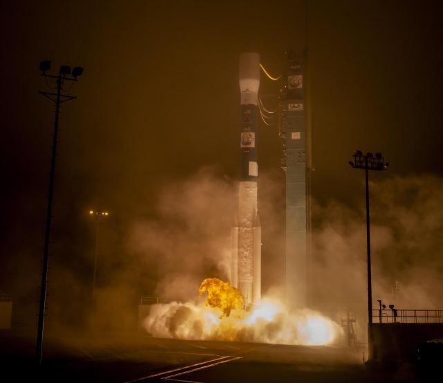 Rocket launch at night.